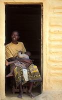 Wa_Arusha woman with baby in homestead, Tanzania, Arusha National Park