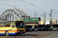 Railway bridge and city traffic with bus, cars and train, Krasta iela street, Riga, Latvia, Republic of Latvia
