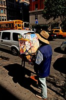 Artist with his easel in the streets of Manhattan, New York City, USA