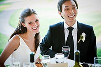 bride and groom laughing, wedding reception