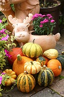 garden sculpture with flowers and pumpkins