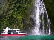 ship in front of waterfal, Milford Sound, New Zealand