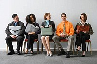 Business executives sitting in a waiting room