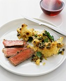 Beefsteak with fried cauliflower and capers