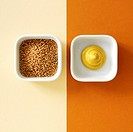 Mustard seeds and mustard overhead view