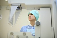 Nurse operating technical equipment in a centre for breast analysis