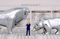 Bull and bear, symbol for the stock exchange, and a businessman, figures