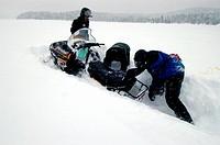 Snowmobile stuck in deep snow, Saguenay-Lac Saint Jean, Mont Valin Region, Quebec, Canada, North America
