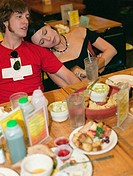 Young couple resting after eating at a restaurant