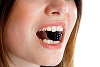 mouth of a young woman with a blackberry