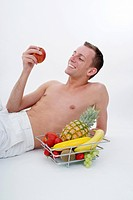 young man with fruits