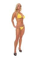 sexy blond bikini girl in a yellow bikini in a sultry full body pose