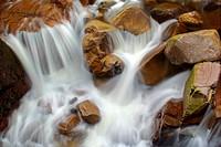 Etive river cascades, water flowing over red rocks, United Kingdom, Scotland, Highlands, Glen Etive