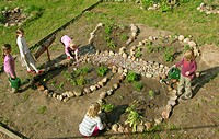 flower bed built by children designed like a butterfly in the garden of a primary school