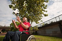 man in wheelchair with ball