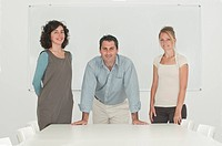office workers in front of whiteboard