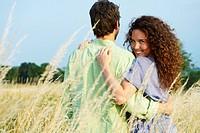 Couple walking in a wheat field