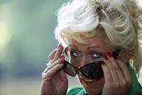 portrait of elderly blond woman with sunglasses