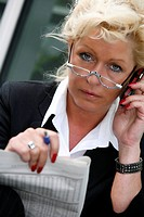 calling business lady studying the share prices