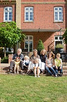 family in front of their home
