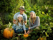Young family with some pumpkins