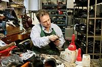 Cobbler, artisan in an old workshop, Muehldorf am Inn, Bavaria, Germany, Europe