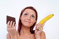 woman with chocolate and banana, sweet or vitamins