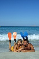 couple with flippers, lying at sandy beach, Spain, Canary Islands, Fuerteventura