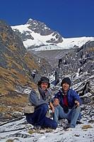Yeshi & myself rest at 15,000 feet below Paldol peak in the GANESH HIMAL, Nepal, Himalaya