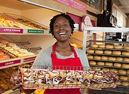 African woman working in donut shop