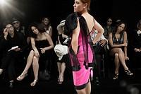 Caucasian model on runway in fashion show