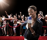 Mixed race broadcaster at red carpet event