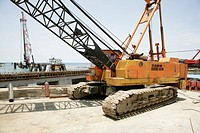 Crawler crane during the building of a refinery and harbour area for the Ramu Nickel Mine, chinese mining company, Basamuk, Papua New Guinea, Melanesi...