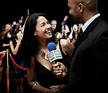 Broadcaster interviewing celebrity
