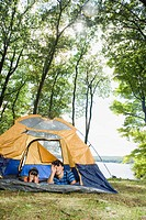 Mixed race father and son camping