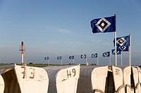Flags of the Hamburger Sport Verein, or HSV, being flown over roofed wicker beach chair as part of the campaign, Die Nordsee zeigt Flagge fuer den HSV...