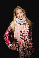 Young woman wearing wrap_around blouse, smiling, portrait
