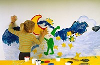 Girl painting with finger colours