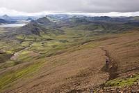 Iceland, Two Men mountain biking in hilly landscape