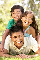 Father And Children Enjoying Day In Park