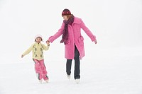 Italy, South Tyrol, Seiseralm, Mother and daughter 4_5 ice skating