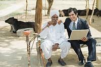 Financial advisor sitting with a farmer