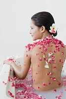 Rear view of a woman getting spa treatment