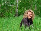 woman sitting in a meadow