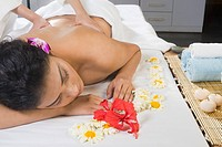Young woman getting back massage from a massage therapist