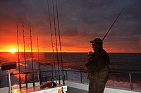 An angler returning to port after a good day shark fishing off of Milford Haven, Wales