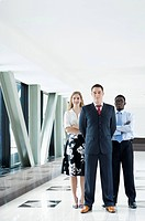 Business people standing together and looking at the camera