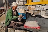 Woman working yak hair, Langtang, Nepal