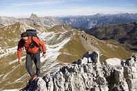 Hiker on ridge, Raetikon, Switzerland