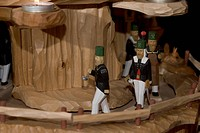 Hand carved miners in a christmas pyramid